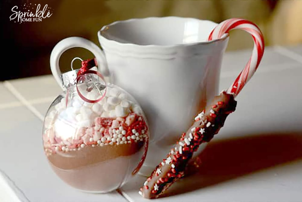 Hot cocoa mix ornaments with chocolate dipped candy canes
