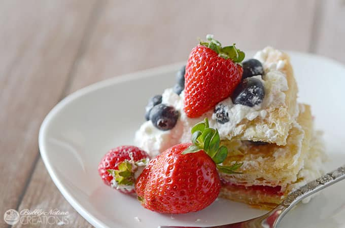 Red White and Blueberry Cream Puff Cake!  Make this impressive dessert easily with puff pastry sheets, whipped cream and fresh berries!!  #WalmartProduce