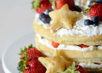 Red White and Blueberry Cream Puff Cake!  Make this impressive dessert easily with puff pastry sheets, whipped cream and fresh berries!