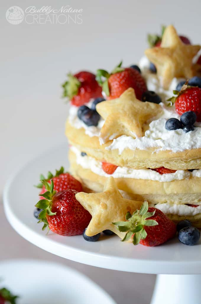 Red White and Blueberry Cream Puff Cake!  Make this impressive dessert easily with puff pastry sheets, whipped cream and fresh berries! #WalmartProduce