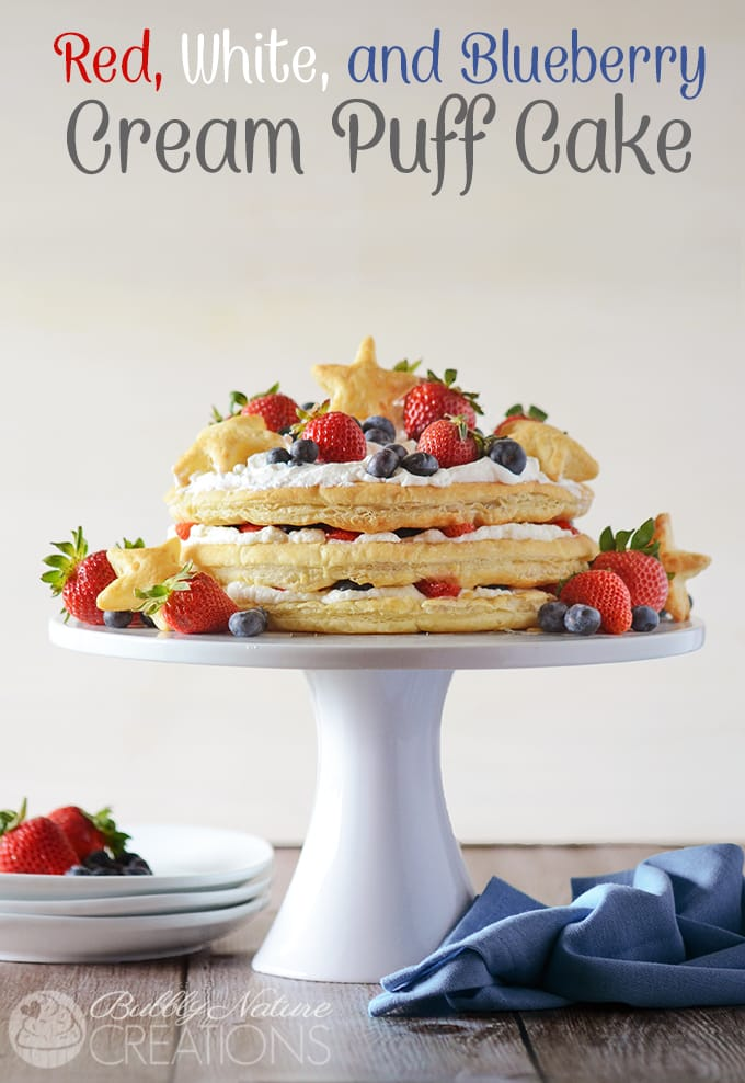 Red White and Blueberry Cream Puff Cake!  Make this impressive dessert easily with puff pastry sheets, whipped cream and fresh berries!!!