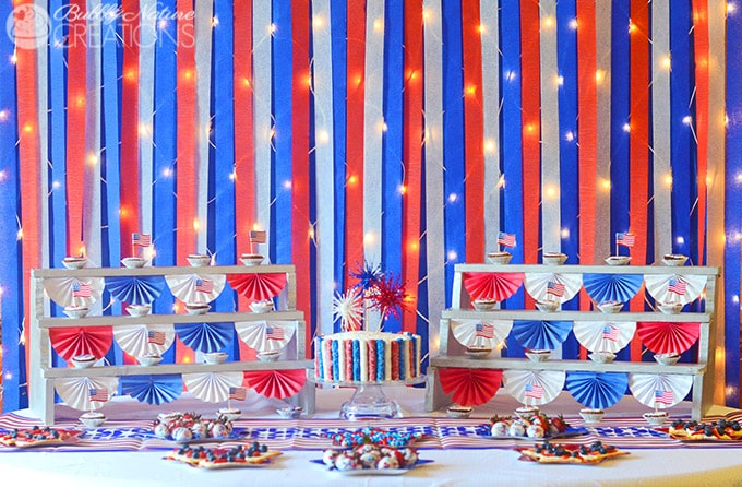 Amazing 4th of July Party with Firework decor and Red White and Blue Sparkle Backdrop!  So fun! #shop