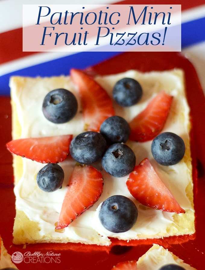 Patriotic Mini Fruit Pizzas! Made with berries, cresent rolls and french vanilla fruit spread! yum!