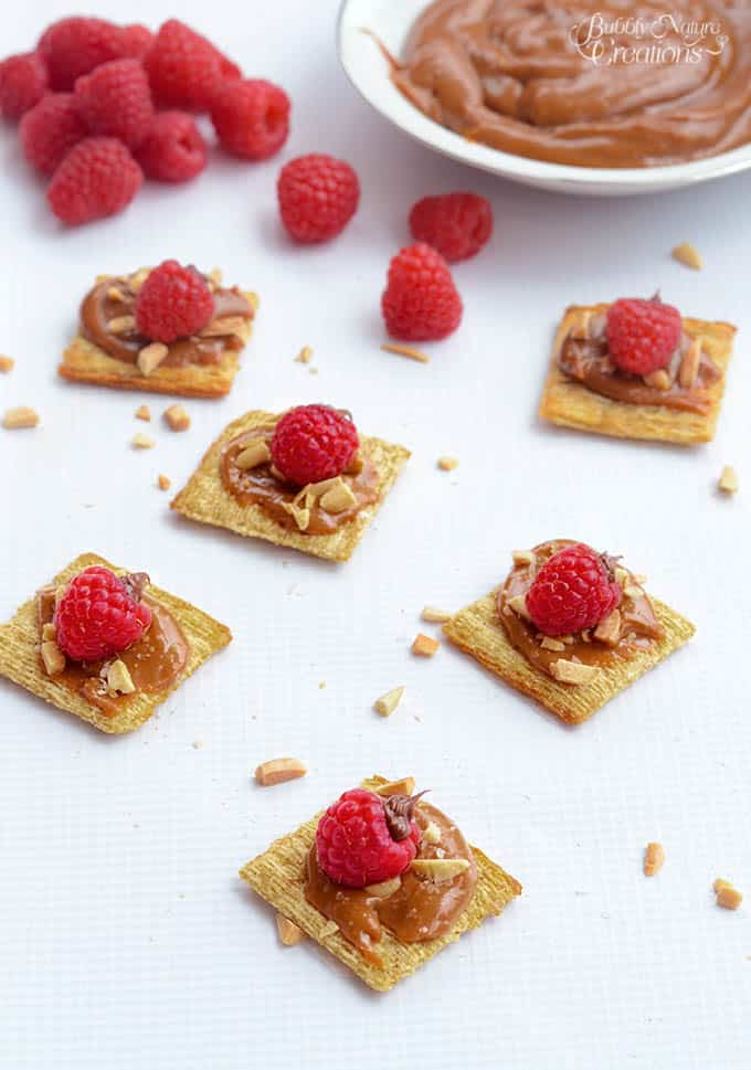 Salted Caramel and Raspberry Triscuits!! A salty sweet combo of Raspberries filled with chocolate, salted caramel and toasted almonds on top of Triscuits! A yummy appetizer! #TriscuitSnackoff