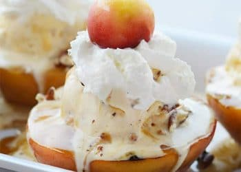 Grilled Peach Sundaes! This Sundae is to die for.  Topped with Buttle Brickle Ice Cream, Prailine Sauce, Whipped Cream, Toasted Pecans and a Rainier Cherry!
