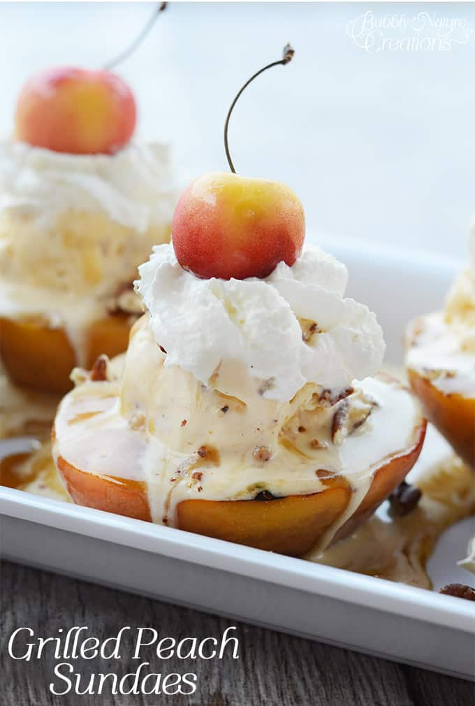 Grilled Peach Sundaes! This Sundae is to die for.  Topped with Buttle Brickle Ice Cream, Prailine Sauce, Whipped Cream, Toasted Pecans and a Rainier Cherry!  #WalmartProduce #ad