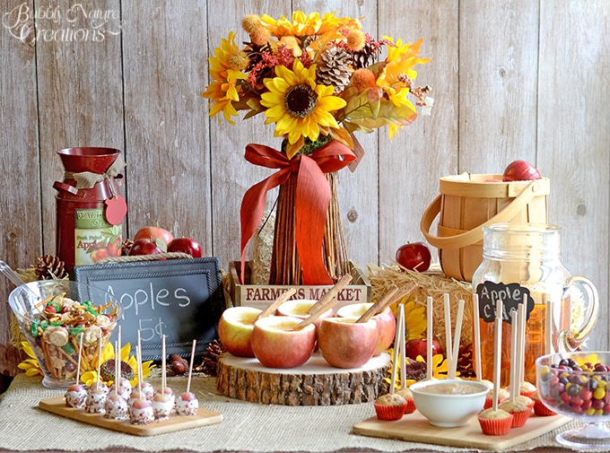 Autumn Apple Party decor with sunflowers and rustic accents!
