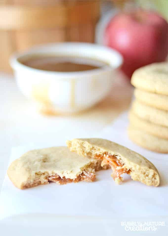 Caramel Stuffed Apple Cider Cookies! These cookies are a great treat anytime you want a taste of fall. I love how the cookie wraps the caramel right inside!