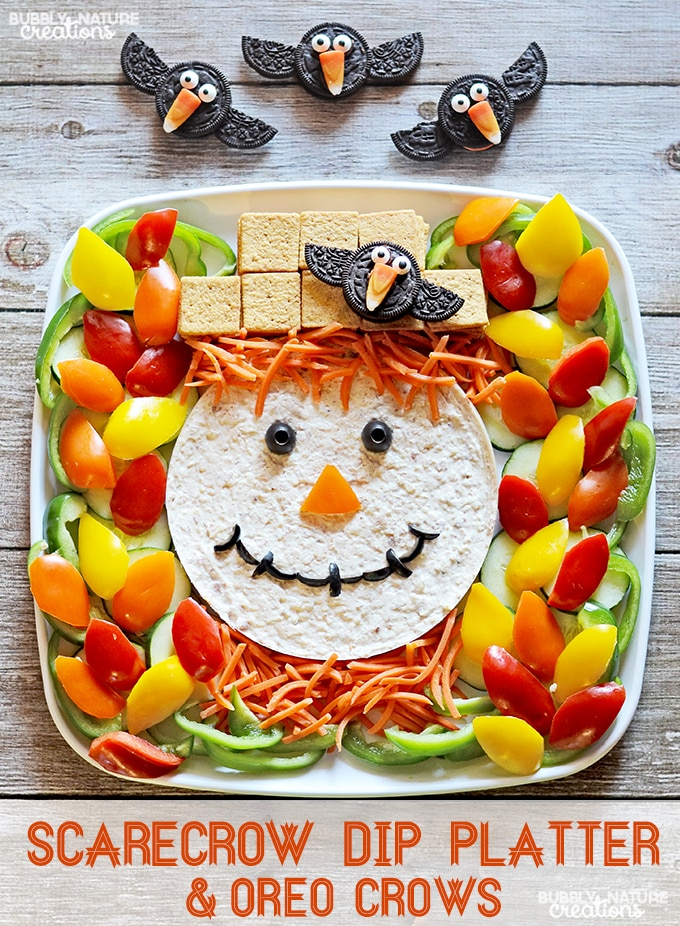 scarecrow dip platter and oreo crows make this cute veggie tray for halloween or thanksgiving