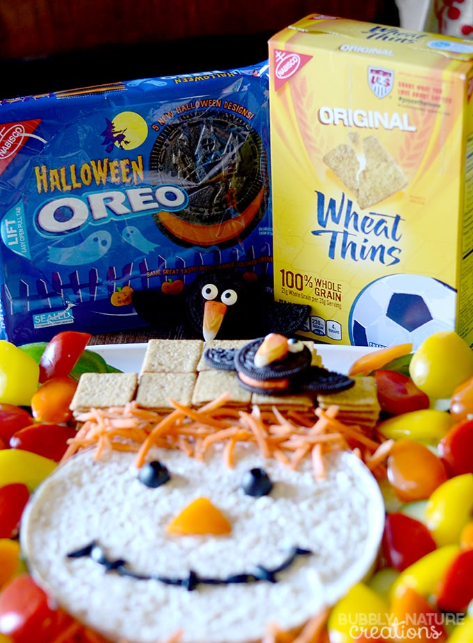 scarecrow dip platter and oreo crows make this cute veggie tray for halloween or