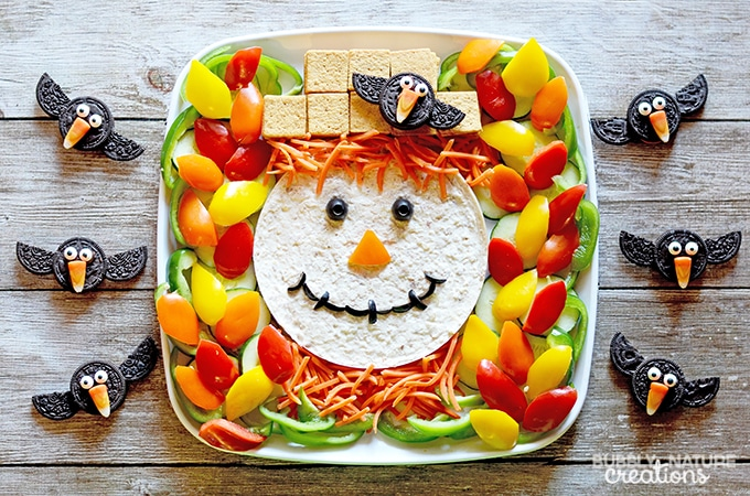 scarecrow veggie tray and oreo crows make this cute veggie tray for halloween or thanksgiving