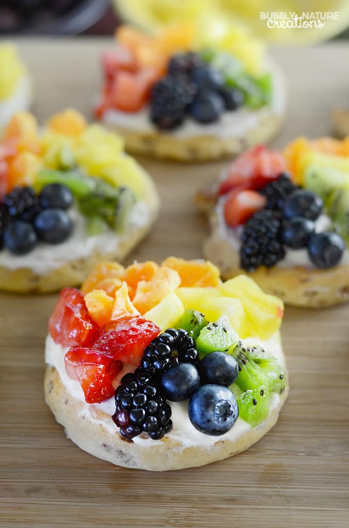 Cinnamon Roll Rainbow Fruit Pizzas!  These taste amazing!