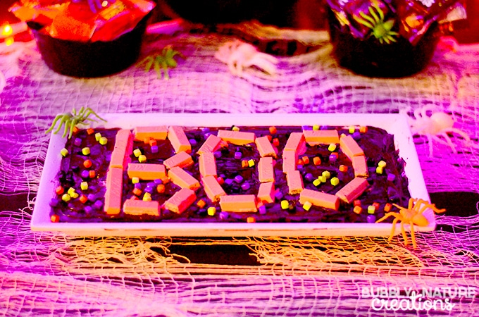 Halloween Glow Party BOO brownies with bright colored Kit Kats and sprinkles to help them glow!