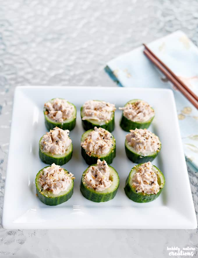 Asian-Inspired Tuna Salad in Cucumber Cups!! Very fresh and tasty way to enjoy tuna salad. Use as an appetizer or lunch idea!