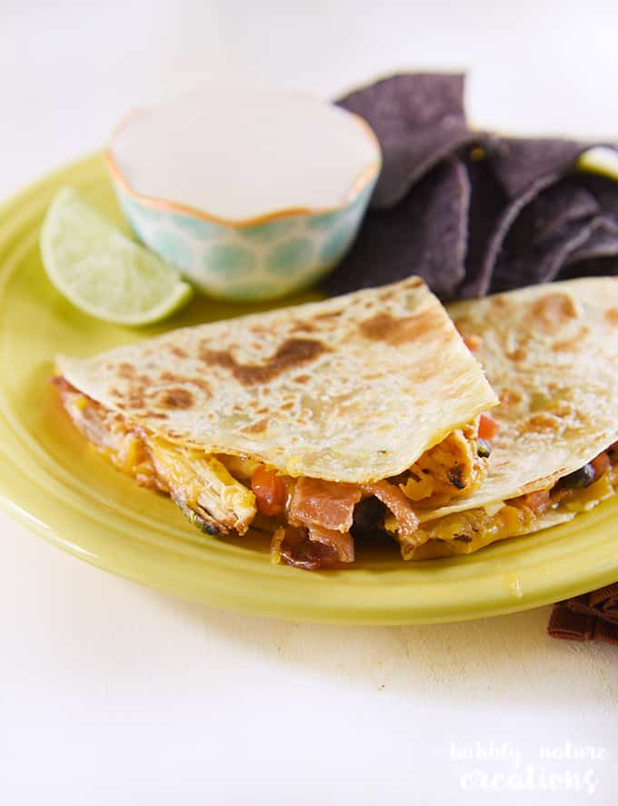 Flame Grilled Chicken Quesedillas! Serve with smoky chipotle lime crema for the ultimate tex mex dinner idea!