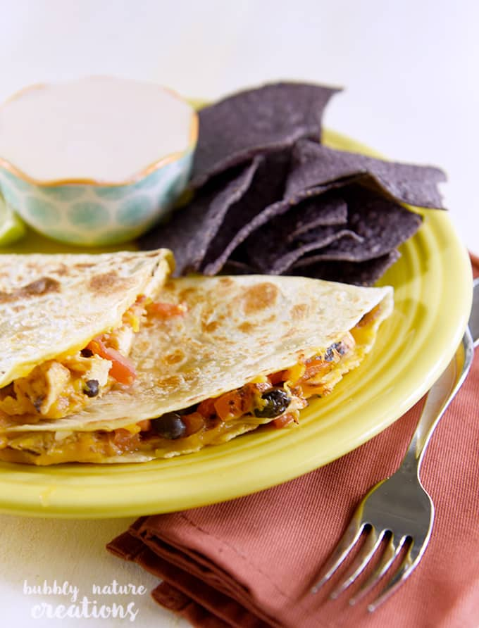 Flame Grilled Chicken Quesedillas. Serve with smoky chipotle lime crema for the ultimate tex mex dinner idea!
