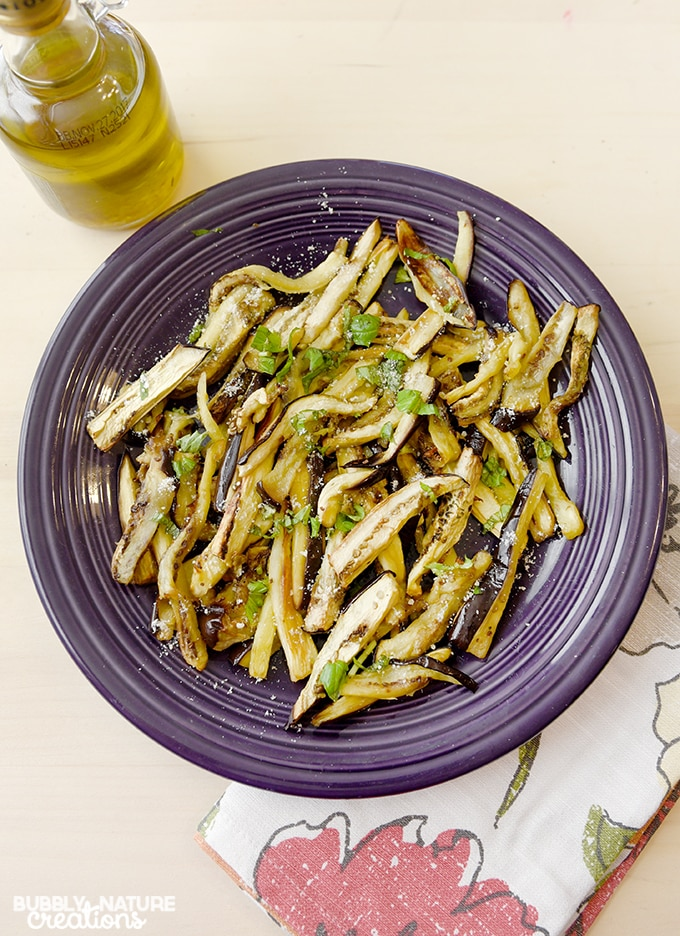 Garlic Roasted Eggplant! Delicious side dish idea with herbs and parmesan to top it off!
