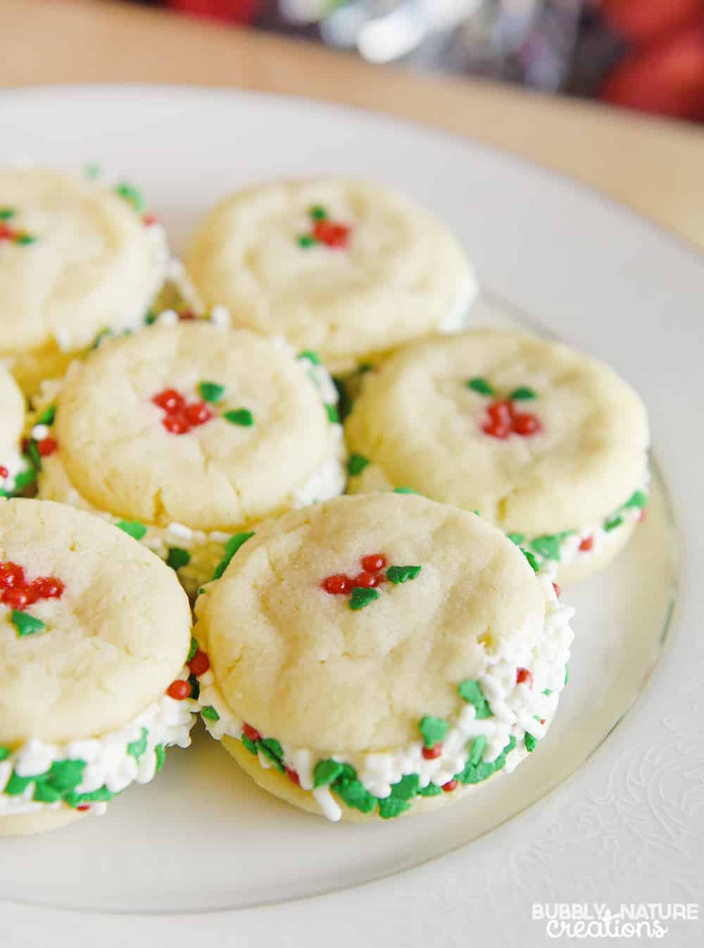 Creamy Cheesecake Filled Sugar Cookie Sandwiches!. Such a delicious recipe for Christmas Cookies!