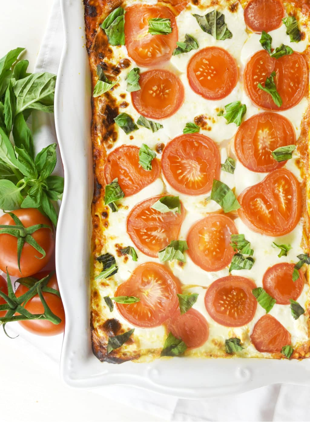 Tomato Basil Baked Spaghetti Casserole! Delicious and creamy with the fresh taste of tomatoes and basil!