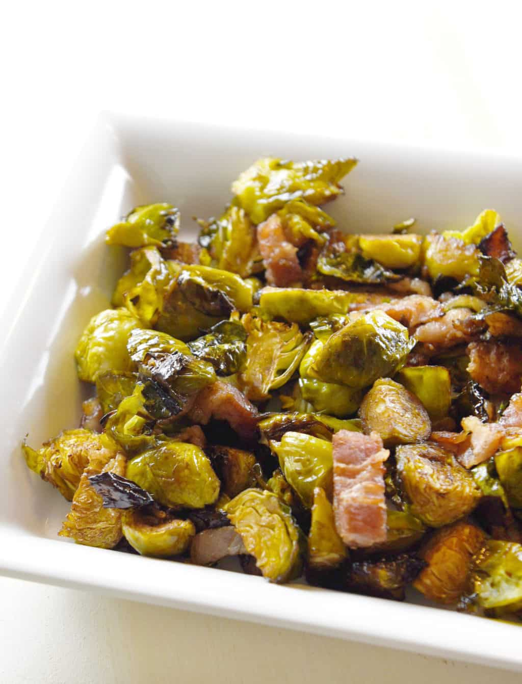 Balsamic and Bacon Roasted Bussels Sprouts!! A favorite side dish loved by all who try it. Sweet, salty and wonderful!