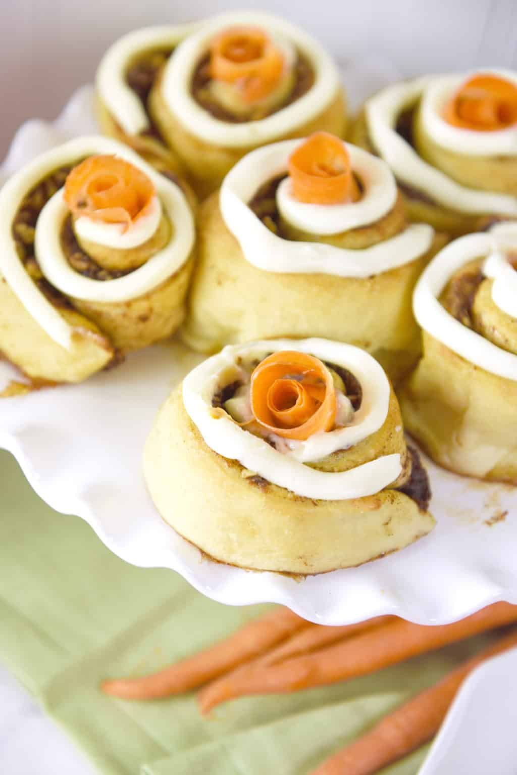 Carrot Cake Cinnamon Rolls!! All the flavors of carrot cake wrapped up in a cinnamon roll! Such a perfect Easter brunch food.