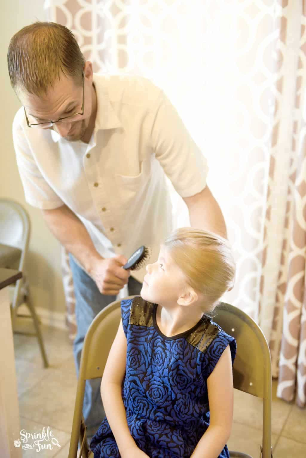 Teaching dads how to do hair!