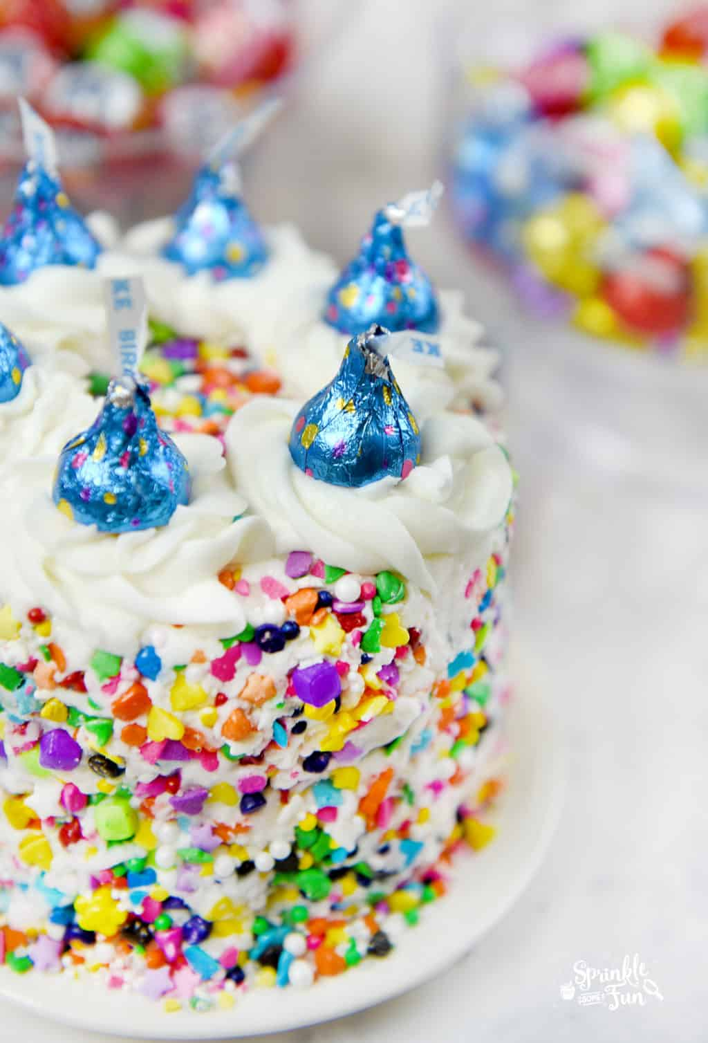 Sprinkle Cake with HERSHEY'S KISSES Birthday Cake Candies makes the perfect birthday cake.