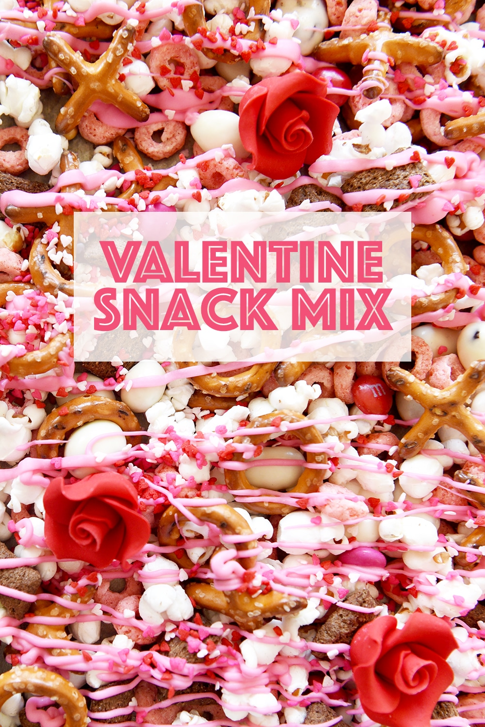 Valentine Snack Mix has pink candy, xoxo pretzels and red roses!  A super cute way to celebrate the holiday for parties and to hand out to classmates.  FREE PRINTABLE Valentine treat bag label when you click the link...