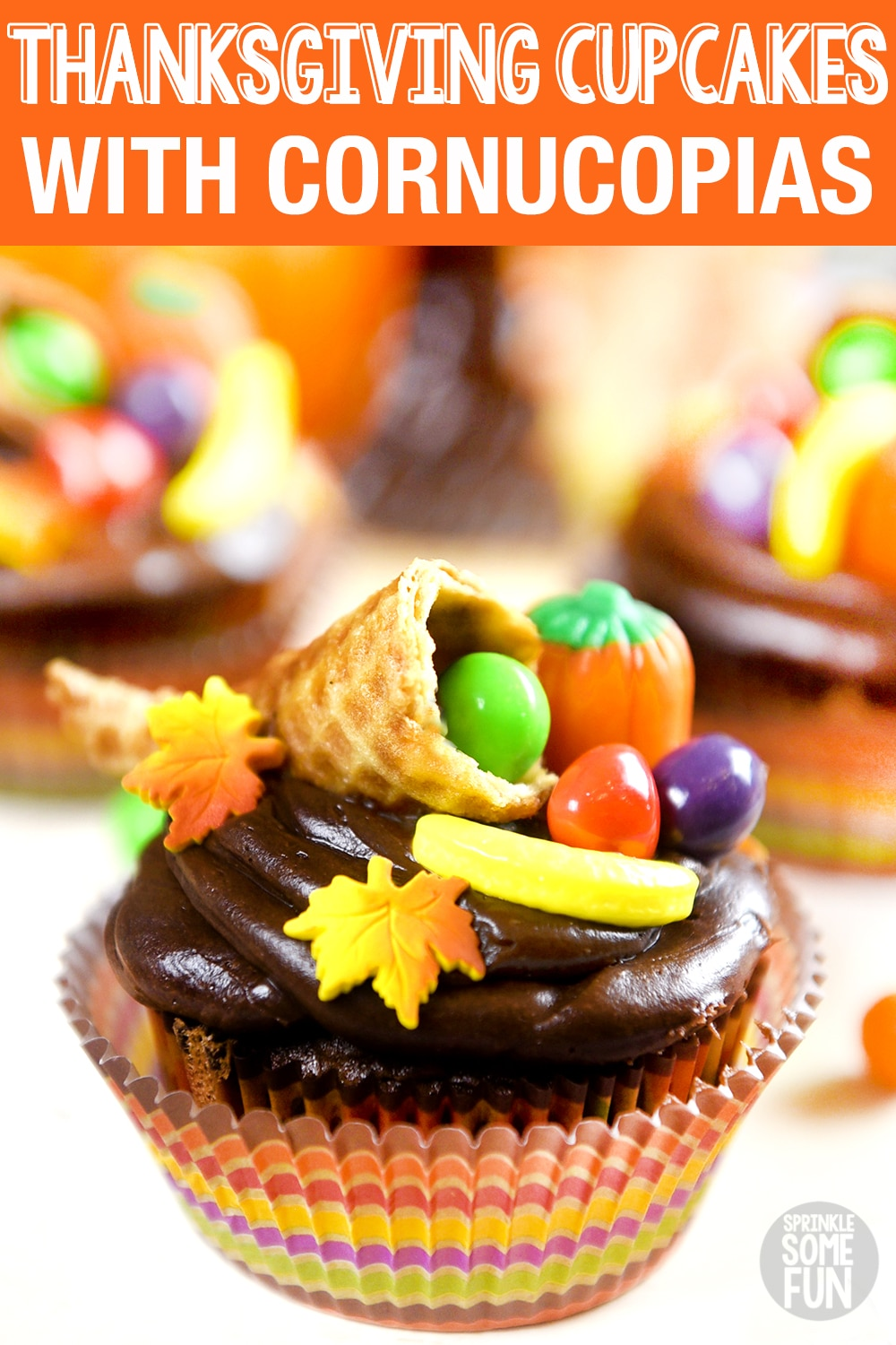 An adorable way to decorate cupcakes for Thanksgiving!  These Thanksgiving cupcakes make the perfect centerpiece for a Thanksgiving dessert table.  Also, they are easy enough that the kids can help make them too. #cupcakes #fall #toppers #Thanksgiving #Thanksgivingcupcakes #Cornucopia #Cornucopiacupcakes #cutecupcakes #fallcupcakes #thanksgivingdecorations #cakedecorating #thanksgivingcupcaketoppers