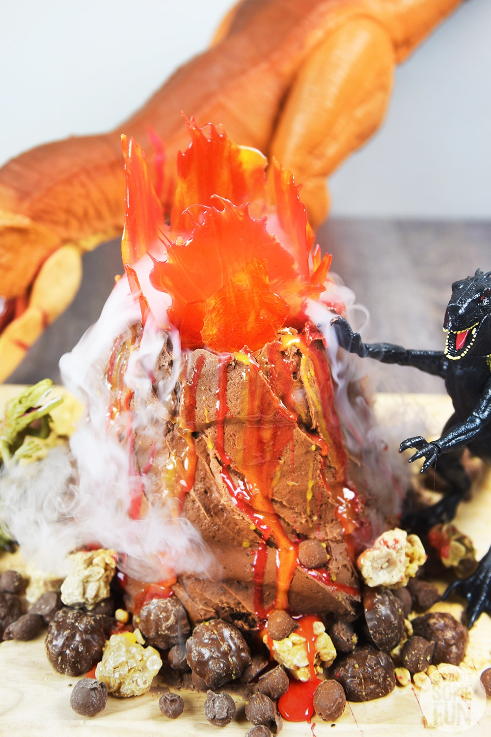 Dinosaur Volcano Cake with steaming Volcano and Steam