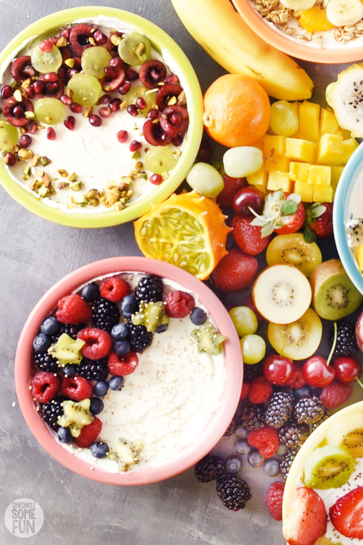 greek yogurt bowls with fruit and toppings