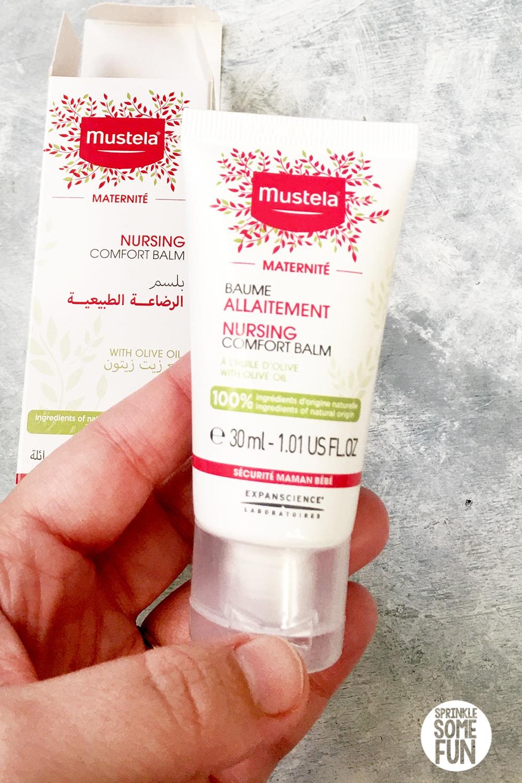 Picture holding Mustela Nursing Balm