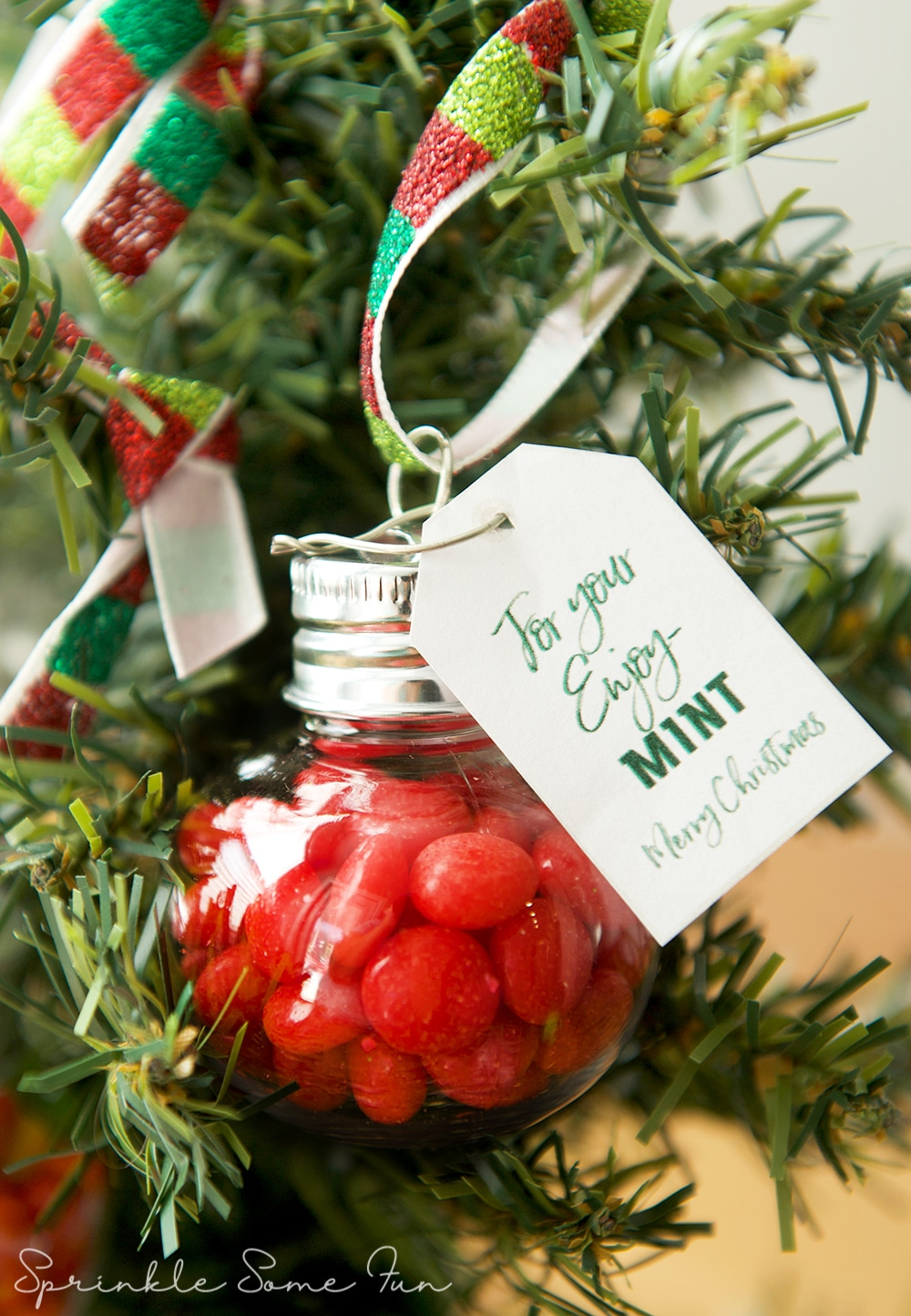 Red Hot Filled Ornament on a Christmas Tree. These Mint Filled Ornaments are a simple holiday gift idea you can give to everyone!