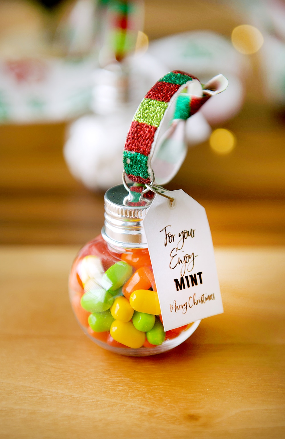 Tic Tacs in a clear ornament with tag.
